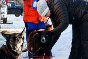 Veterinarian checks a dog during the pre-race vet check at Iditarod Headquarters in Wasilla, Alaska. Wednesday February 26, 2019 Photo by Jeff Schultz/  (C) 2019  ALL RIGHTS RESERVED