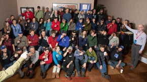 The 52 mushers signed up for the 2019 Iditarod race gather for a group photo and a toast  from hotel manager Greg Beltz at the mandatory musher meeting at the Lakefront Anchorage hotel in Anchorage, Alaska. Thursday February 28, 2019 Photo by Jeff Schultz/  (C) 2019  ALL RIGHTS RESERVED