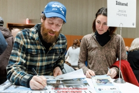 Jessie Holmes signs an autograph for a race fan at the musher pre-race banquet at the Denaina Convention center for Iditarod 2019Photo by Jeff Schultz/  (C) 2019  ALL RIGHTS RESERVED