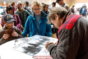 Martin Buser signs autographs for races fans at the musher pre-race banquet at the Dena'ina Convention center for Iditarod 2019Photo by Jeff Schultz/  (C) 2019  ALL RIGHTS RESERVED