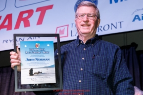 John Norman shows off his plaque after receiving the Iditarod Trail Foundation Founders award at the pre-race musher drawing banquet at the Dena'ina convention center in Anchorage, Alaska prior to the 2019 Iditarod Trail Sled Dog RacePhoto by Jeff Schultz/  (C) 2019  ALL RIGHTS RESERVED