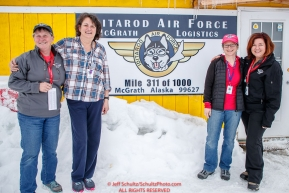 McGrath logistics volunteers, Diana Moroney, Deb Miller, Darcy Harris and Jodie Guest pose for a photo outide their office at the McGrath checkpoint during the 2018 Iditarod race on Wednesday March 07, 2018. Photo by Jeff Schultz/SchultzPhoto.com  (C) 2018  ALL RIGHTS RESERVED