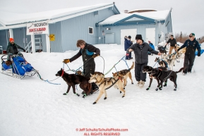 McGrath volunteers back out Bradley Farquar's team from its parking spot in the afternoon at the McGrath checkpoint during the 2018 Iditarod race on Wednesday March 07, 2018. Photo by Jeff Schultz/SchultzPhoto.com  (C) 2018  ALL RIGHTS RESERVED