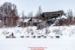 Jeff King runs past a derelict building as he approaches the ghost town of Iditarod on Thursday, March 8th during the 2018 Iditarod Sled Dog Race -- AlaskaPhoto by Jeff Schultz/SchultzPhoto.com  (C) 2018  ALL RIGHTS RESERVED
