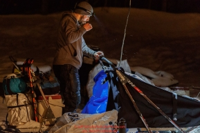 Richie Diehl brushes his teeth as he prepares to leave the Takotna checkpoint after his 24-hour layover on Thursday morning, March 8th during the 2018 Iditarod Sled Dog Race -- AlaskaPhoto by Jeff Schultz/SchultzPhoto.com  (C) 2018  ALL RIGHTS RESERVED