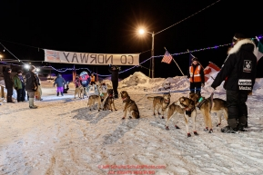 Allen Moore holds his wife's leaders as Aliy Zirkle prepares to leave the Takotna checkpoint after their 24-hour layover on Thursday, March 8th during the 2018 Iditarod Sled Dog Race -- AlaskaPhoto by Jeff Schultz/SchultzPhoto.com  (C) 2018  ALL RIGHTS RESERVED