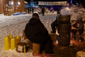 Takotna residents keep dog water hot as Aliy Zirkle prepares to leave the Takotna checkpoint after her 24-hour layover early on Thursday, March 8th during the 2018 Iditarod Sled Dog Race -- AlaskaPhoto by Jeff Schultz/SchultzPhoto.com  (C) 2018  ALL RIGHTS RESERVED