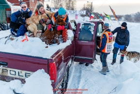 Volunteers load dropped dogs into a truck for a ride to the airport at the Takotna checkpoint on Thursday, March 8th during the 2018 Iditarod Sled Dog Race -- AlaskaPhoto by Jeff Schultz/SchultzPhoto.com  (C) 2018  ALL RIGHTS RESERVED