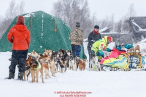 Volunteers check in Monica Zappa at the Iditarod checkpoint on Friday, March 9th during the 2018 Iditarod Sled Dog Race -- AlaskaPhoto by Jeff Schultz/SchultzPhoto.com  (C) 2018  ALL RIGHTS RESERVED