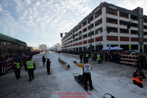 Linwood Fiedler runs down 4th Avenue during the ceremonial start of the 2019 Iditarod in downtown Anchorage, Alaska on Saturday March 2.Photo by Jeff Schultz/  (C) 2019  ALL RIGHTS RESERVED