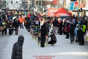 Matt Hall's handlers bring him slowly down 4th avenue to the start line during the 2019 ceremonial start of the Iditarod in downtown Anchorage, Alaska on Saturday March 2.Photo by Jeff Schultz/  (C) 2019  ALL RIGHTS RESERVED