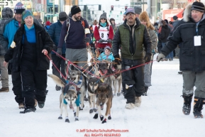 Volunteer dog handlers bring Kristin Bacon team to the start line on 4th avenue during the 2019 ceremonial start of the Iditarod in downtown Anchorage, Alaska on Saturday March 2.Photo by Jeff Schultz/  (C) 2019  ALL RIGHTS RESERVED