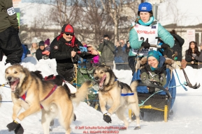 Jessica Klejka and Iditarider Terrie Hanke take the turn on Cordova Street during the 2019 ceremonial start of the Iditarod in downtown Anchorage, Alaska on Saturday March 2.Photo by Jeff Schultz/  (C) 2019  ALL RIGHTS RESERVED