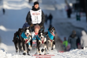 Charlie Benja runs down Cordova Street during the ceremonial start of the 2019 Iditarod in downtown Anchorage, Alaska on Saturday March 2.Photo by Jeff Schultz/  (C) 2019  ALL RIGHTS RESERVED