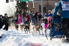 Brett Bruggeman gives high-fives on Cordova Street with his Iditarider during the ceremonial start of the 2019 Iditarod in downtown Anchorage, Alaska on Saturday March 2.Photo by Jeff Schultz/  (C) 2019  ALL RIGHTS RESERVED