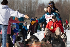 Sarah Stokey and her Iditarider run down the bike/ski trail during the ceremonial start of the 2019 Iditarod in midtown Anchorage, Alaska on Saturday March 2.Photo by Jeff Schultz/  (C) 2019  ALL RIGHTS RESERVED