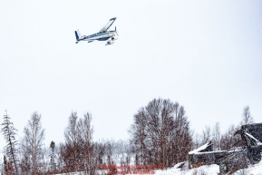 Pilot Jerry Wortley climbs out after take-off from the ghost-town checkpoint of Iditarod on Saturday, March 10th during the 2018 Iditarod Sled Dog Race -- AlaskaPhoto by Jeff Schultz/SchultzPhoto.com  (C) 2018  ALL RIGHTS RESERVED