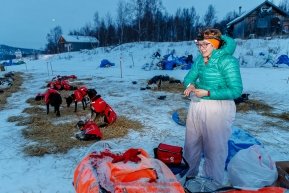 Meredith Mapes begins her dog chores in the early morning hours at the ghost-town checkpoint of Iditarod on Saturday, March 10th during the 2018 Iditarod Sled Dog Race -- AlaskaPhoto by Jeff Schultz/SchultzPhoto.com  (C) 2018  ALL RIGHTS RESERVED