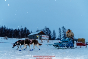Lev Shvarts leaves on the trail in the early morning hours at the ghost-town checkpoint of Iditarod on Saturday, March 10th during the 2018 Iditarod Sled Dog Race -- AlaskaPhoto by Jeff Schultz/SchultzPhoto.com  (C) 2018  ALL RIGHTS RESERVED