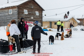 Kids watch from a roof top as Robert Redington arrives at the Kaltag checkpoint on Sunday afternoon March 10th during the 2019 Iditarod Trail Sled Dog Race.Photo by Jeff Schultz/  (C) 2019  ALL RIGHTS RESERVED