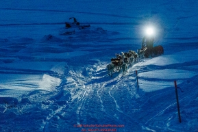 With his headlamp shining the way, Linwood Fiedler runs on the Yukon River as he approaches the Kaltag checkpoint on Sunday  morning March 10th during the 2019 Iditarod Trail Sled Dog Race.Photo by Jeff Schultz/  (C) 2019  ALL RIGHTS RESERVED