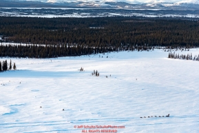 A team runs on the trail between Kaltag and Unalakleet on Sunday evening March 11th during the 2018 Iditarod Sled Dog Race -- AlaskaPhoto by Jeff Schultz/SchultzPhoto.com  (C) 2018  ALL RIGHTS RESERVED