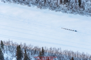A team runs on the Unalakleet River trail nearing Unalakleet on Sunday evening March 11th during the 2018 Iditarod Sled Dog Race -- AlaskaPhoto by Jeff Schultz/SchultzPhoto.com  (C) 2018  ALL RIGHTS RESERVED