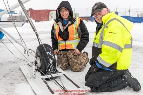 Pilots Daniel Hayden and Jerry Wortley work on his wheel-skis during a weather hold at the Unalakleet checkpoint on Monday  morning March 12th during the 2018 Iditarod Sled Dog Race -- AlaskaPhoto by Jeff Schultz/SchultzPhoto.com  (C) 2018  ALL RIGHTS RESERVED