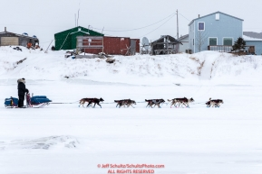 Mike Williams Jr. runs on the slough as he arrives at the Unalakleet checkpoint on Monday  afternoon March 12th during the 2018 Iditarod Sled Dog Race -- AlaskaPhoto by Jeff Schultz/SchultzPhoto.com  (C) 2018  ALL RIGHTS RESERVED
