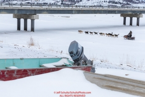 Jeff King runs under the bridge on the Kouwegok slough shortly after leaving the Unalakleet checkpoint on Monday  afternoon March 12th during the 2018 Iditarod Sled Dog Race -- AlaskaPhoto by Jeff Schultz/SchultzPhoto.com  (C) 2018  ALL RIGHTS RESERVED