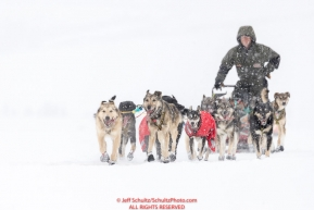 Jeff King runs on the trail in a snowstorm nearing the Unalakleet checkpoint on Monday  afternoon March 12th during the 2018 Iditarod Sled Dog Race -- AlaskaPhoto by Jeff Schultz/SchultzPhoto.com  (C) 2018  ALL RIGHTS RESERVED