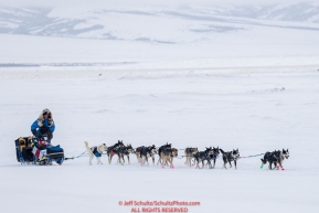 Larry Daugherty runs on the slough as he arrives at the Unalakleet checkpoint on Monday  afternoon March 12th during the 2018 Iditarod Sled Dog Race -- AlaskaPhoto by Jeff Schultz/SchultzPhoto.com  (C) 2018  ALL RIGHTS RESERVED