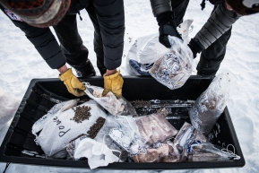 Cripple checkpoint volunteers sorting through left over food from mushers drop bags.