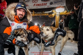 Pete Kaiser congratulates his lead dogs at the Nome finish line shortly after winning the 2019 Iditarod Trail Sled Dog Race. Pete's winning time is 9 days 12 hours 39 minutes and 6 secondsPhoto by Jeff Schultz/  (C) 2019  ALL RIGHTS RESERVED