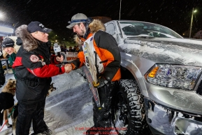 Pete Kaiser accepts his winner's truck from Chuck Talskey of Anchorage Chrysler Dodge at the Nome finish line after winning the 2019 Iditarod Trail Sled Dog Race. Pete's winning time is 9 days 12 hours 39 minutes and 6 secondsPhoto by Jeff Schultz/  (C) 2019  ALL RIGHTS RESERVED
