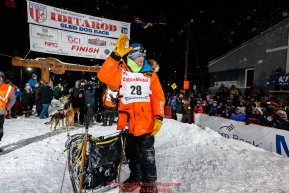 Second place finisher Joar Leifseth Ulsom waves to the crowd shortly after finishing the 2019 Iditarod Trail Sled Dog Race. Photo by Jeff Schultz/  (C) 2019  ALL RIGHTS RESERVED