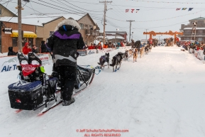 Jessie Royer runs down the finish chute as she makes her way toward the Nome finish line to place 3rd in the 2019 Iditarod sled dog race.Photo by Jeff Schultz/  (C) 2019  ALL RIGHTS RESERVED