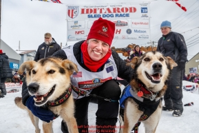 Aliy Zirkle poses with her lead dogs at the Nome finish line with her lead dogs Mismo and Dutch after placing 4th in the 2019 Iditarod on Wednesday March 13Photo by Jeff Schultz/  (C) 2019  ALL RIGHTS RESERVED