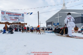 Travis Beals runs into the finish chute in Nome for 5th place during the 2019 Iditarod on Wednesday March 13Photo by Jeff Schultz/  (C) 2019  ALL RIGHTS RESERVED