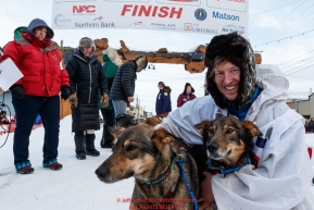 Travis Beals poses with his leaders in the finish chute in Nome after taking 5th place during the 2019 Iditarod on Wednesday March 13Photo by Jeff Schultz/  (C) 2019  ALL RIGHTS RESERVED