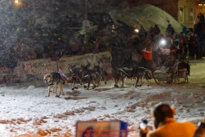 Pete Kaiser runs down Nome's Front Street and into the finish chute  to win the 2019 Iditarod Trail Sled Dog Race. Pete's winning time is 9 days 12 hours 39 minutes and 6 secondsPhoto by Jeff Schultz/  (C) 2019  ALL RIGHTS RESERVED