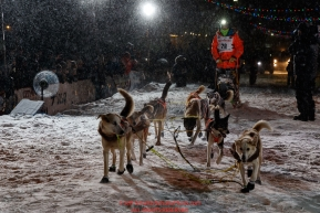 Joar Leifseth Ulsom runs up the finish chute to place second during  the 2019 Iditarod Trail Sled Dog Race. Photo by Jeff Schultz/  (C) 2019  ALL RIGHTS RESERVED