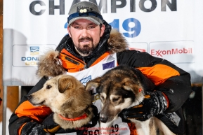 Pete Kaiser poses with his Marrow (L) and Lucy at the Nome finish line after winning the 2019 Iditarod Trail Sled Dog Race. Pete's winning time is 9 days 12 hours 39 minutes and 6 secondsPhoto by Jeff Schultz/  (C) 2019  ALL RIGHTS RESERVED
