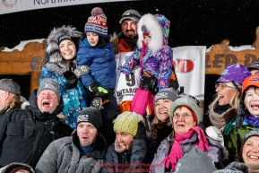 Pete Kaiser and family pose with friends and family from Bethel, Alaska at the Nome finish line after Pete wins the 2019 Iditarod Trail Sled Dog Race. Pete's winning time is 9 days 12 hours 39 minutes and 6 secondsPhoto by Jeff Schultz/  (C) 2019  ALL RIGHTS RESERVED