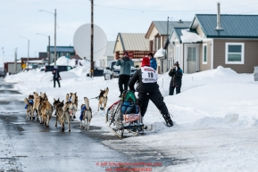 Aliy Zirkle runs down Front Street in Nome on her way to a 4th place finish during the 2019 Iditarod on Wednesday March 13Photo by Jeff Schultz/  (C) 2019  ALL RIGHTS RESERVED
