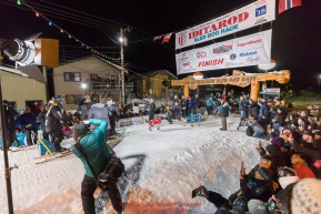 Joar Leifseth Ulsom runs across the finish line in Nome, Alaska early on Wednesday morning March 14th as he wins the 46th running of the 2018 Iditarod Sled Dog Race.  He finished in 9 days 12 hours 00 minutes and 00 secondsPhoto by Jeff Schultz/SchultzPhoto.com  (C) 2018  ALL RIGHTS RESERVED
