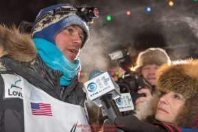 Joar Leifseth Ulsom talks with reporters at the finish line in Nome, Alaska early on Wednesday morning March 14th as he wins the 46th running of the 2018 Iditarod Sled Dog Race.  He finished in 9 days 12 hours 00 minutes and 00 secondsPhoto by Jeff Schultz/SchultzPhoto.com  (C) 2018  ALL RIGHTS RESERVED