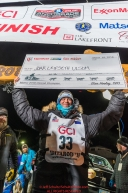 Joar Leifseth Ulsom holds up his winner's check at the finish line in Nome, Alaska early on Wednesday morning March 14th as he wins the 46th running of the 2018 Iditarod Sled Dog Race.  He finished in 9 days 12 hours 00 minutes and 00 secondsPhoto by Jeff Schultz/SchultzPhoto.com  (C) 2018  ALL RIGHTS RESERVED