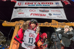 Mitch Seavey poses at the finish line in Nome, Alaska early on Wednesday morning March 14th after he placed 3rd in the 46th running of the 2018 Iditarod Sled Dog Race.  Photo by Jeff Schultz/SchultzPhoto.com  (C) 2018  ALL RIGHTS RESERVED
