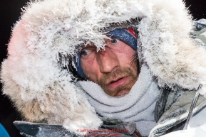 Nick Petit is frosted up at the finish line in Nome, Alaska early on Wednesday morning March 14th as places 2nd in the 46th running of the 2018 Iditarod Sled Dog Race.  Photo by Jeff Schultz/SchultzPhoto.com  (C) 2018  ALL RIGHTS RESERVED